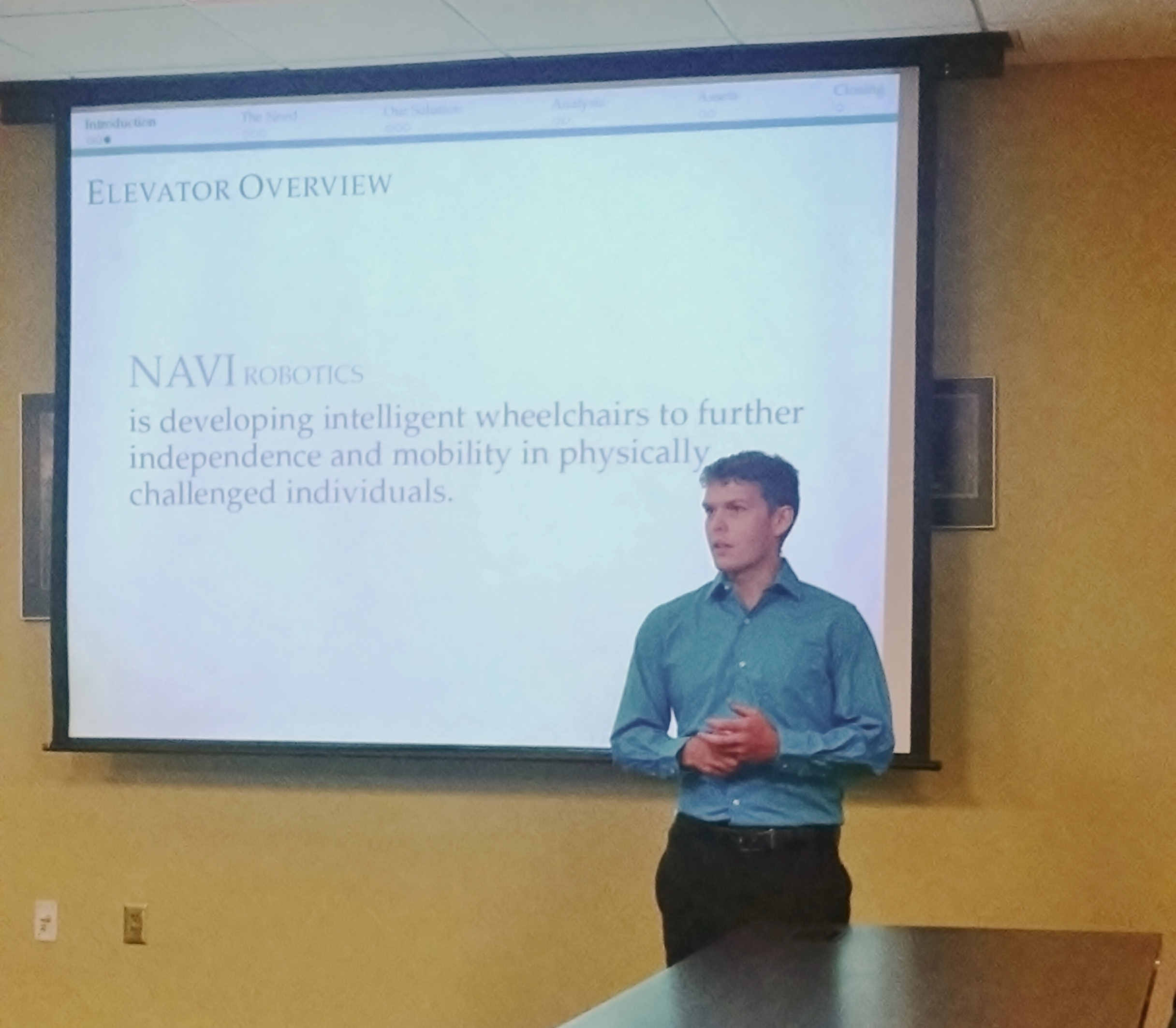 Engineering Accelerator student Dan Nix gives his team's elevator pitch to the MBA students from the University of South Dakota.