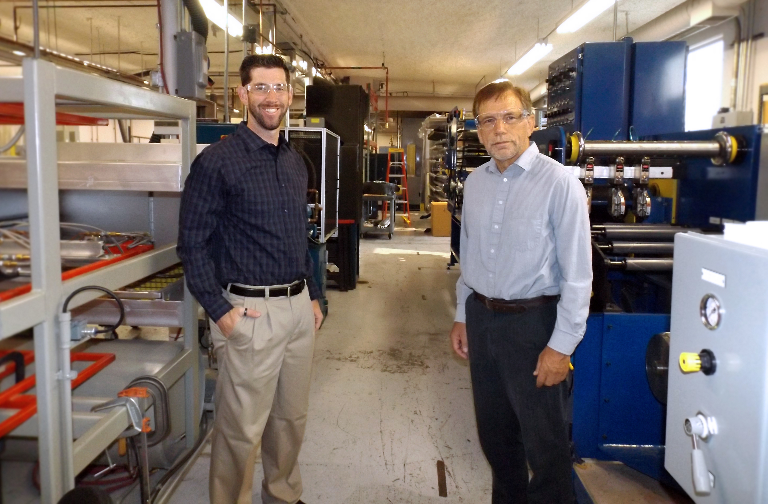 Eric Schmid (left) and Dr. David Salem (right) stand in their lab space at the CAPE Laboratory.