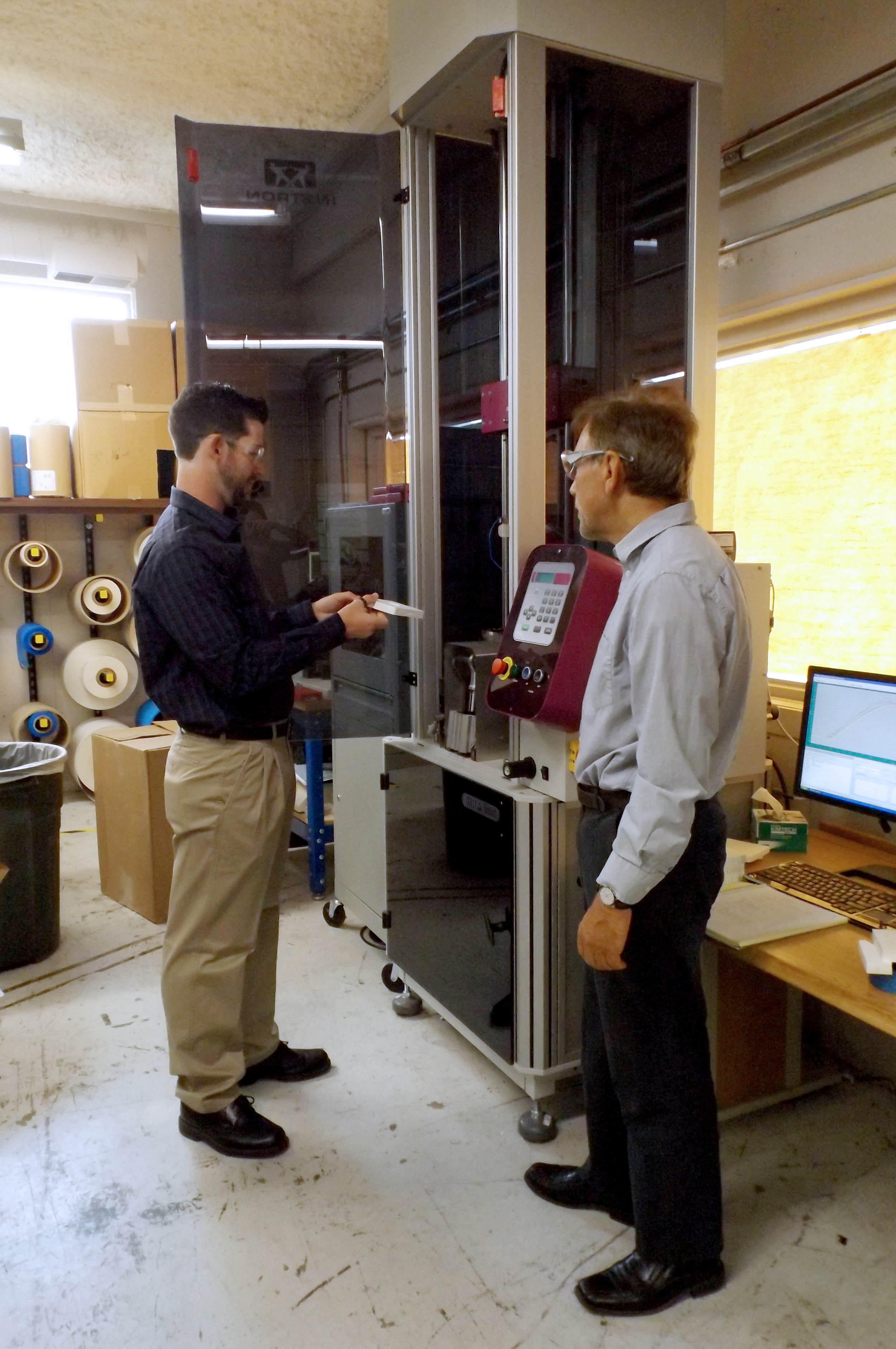 Eric and Dr. Salem working with the CEAST 9350 Impact Tester, one of the many pieces of equipment at the CAPE Laboratory.