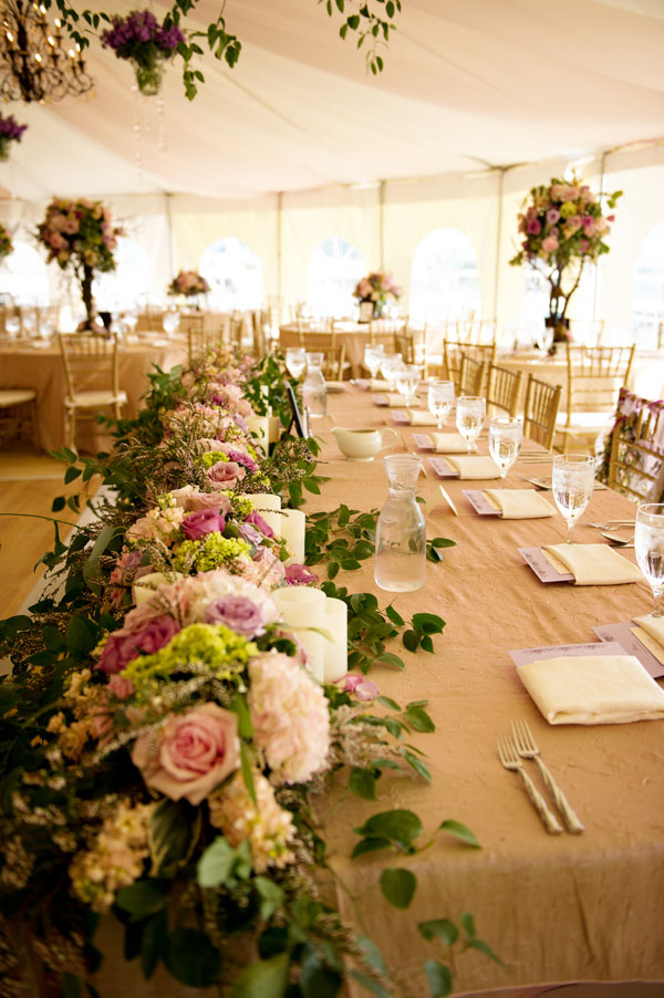 The Flower House - head table with flower garland.jpg