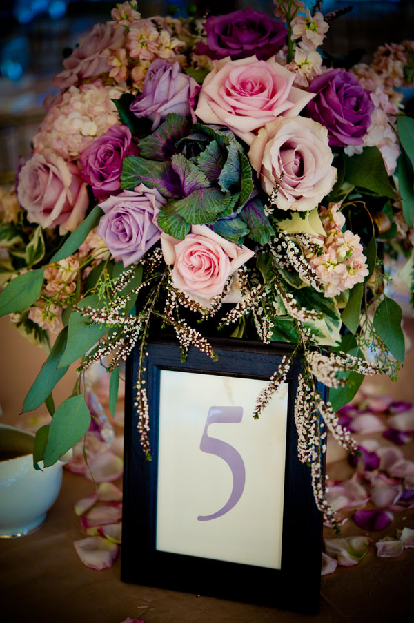 The Flower House - Centerpiece with pink and lavender roses.jpg