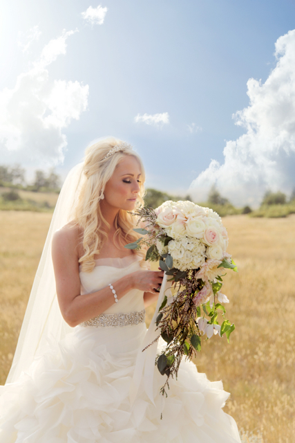 The Flower House Denver - Bride with White cascading bouquet of white flowers.jpg