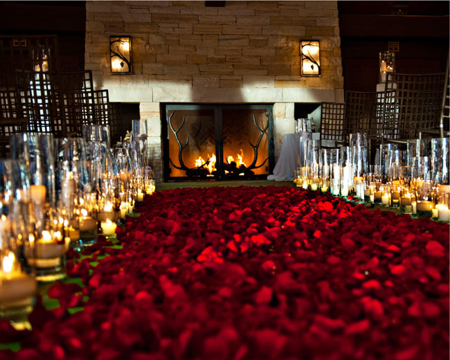 The Flower House Denver Red Petal Aisle with Candles.jpg