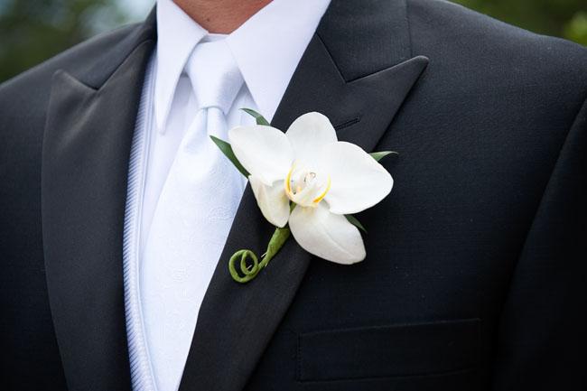 white phalaenopsis boutonniere.jpg