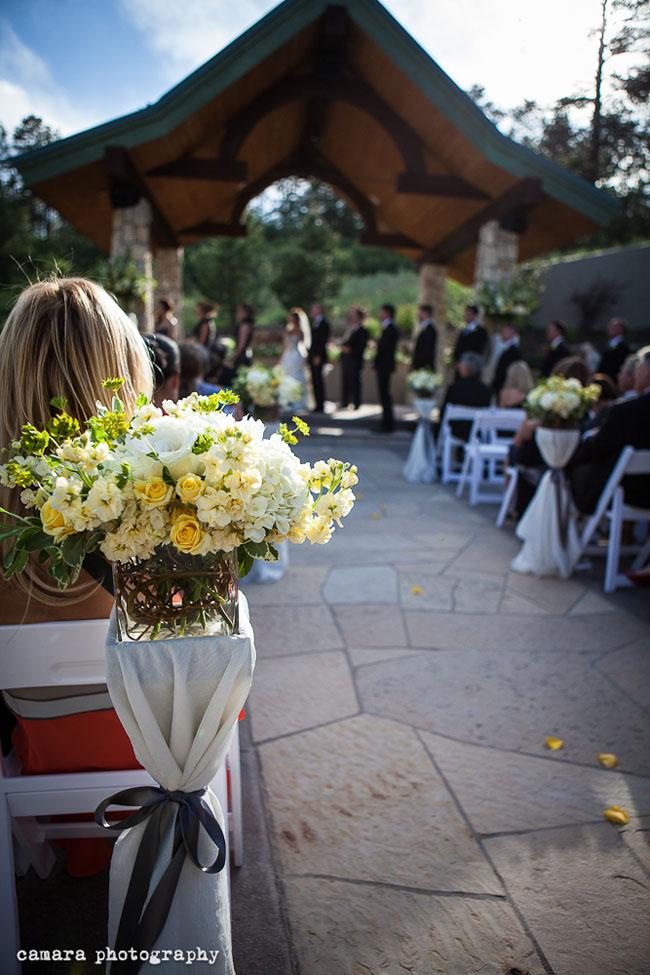ceremony aisle with creamy yellow flowers.jpg