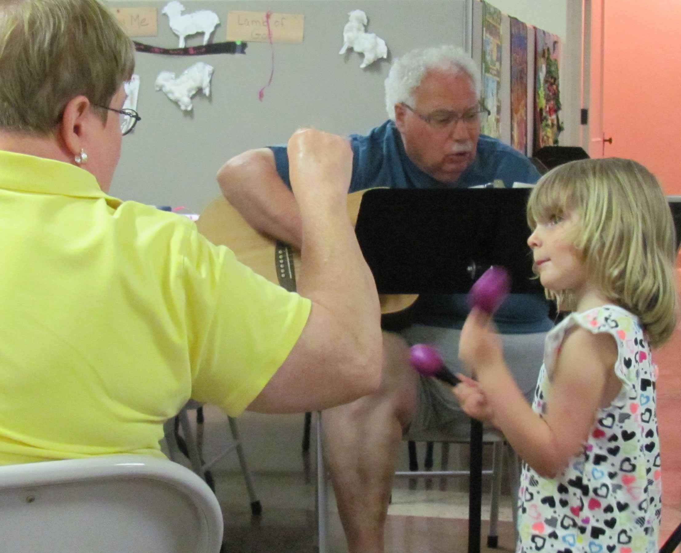 Charles and Kathy Volland make music with their granddaughter.