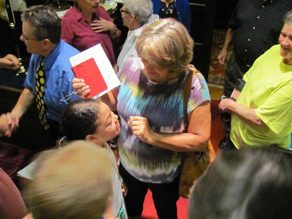 Passing the peace at St. John's on Social Media Sunday.