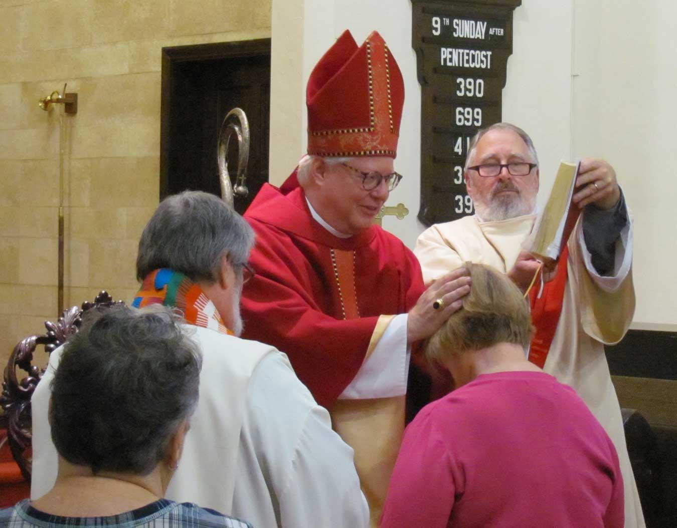 Bishop Wolfe confirming Kathy DeVore