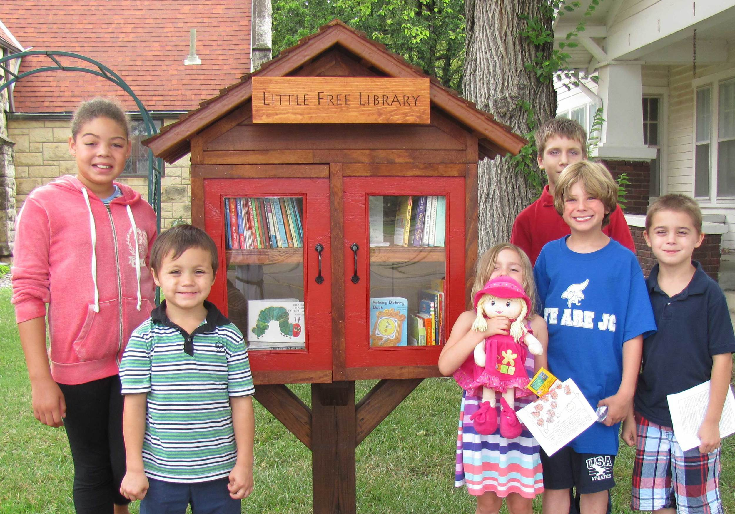 Young parishioners donated books to start the Little Free Library St. John's hosts.