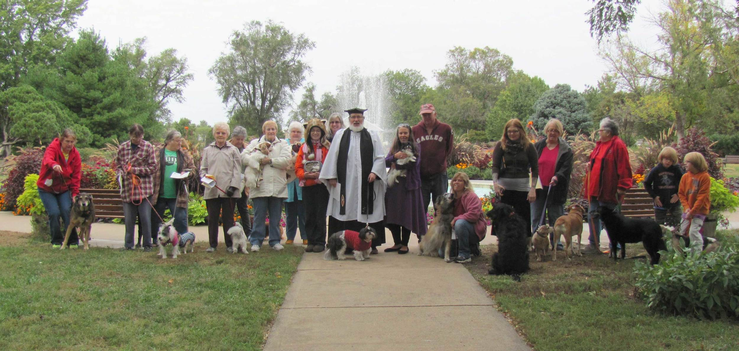 A happy group of pets and their human companions gathered for blessings.