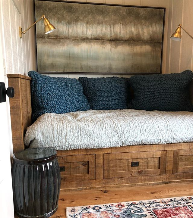 One of my favorite spots at one of our recent lake house projects! This built-in queen bed also doubles as a lounging area for the teen who will occupy this room. #givemeallthebooks #yesplease #sleepingquarters #relaxingspace #interiordesign #customdesign #millwork #tinyspaces #builtins #lakelife #lakemartin