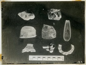 Photograph of glass fragments, including the spoon, from the vicinity of the south end of the Summit.