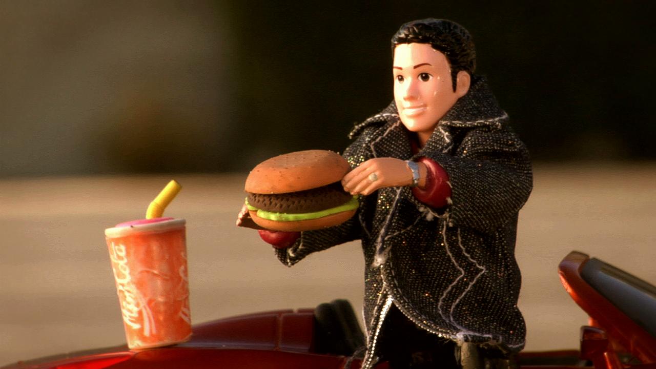 RJD2 - The Glow - screengrab - eating a burger.jpeg