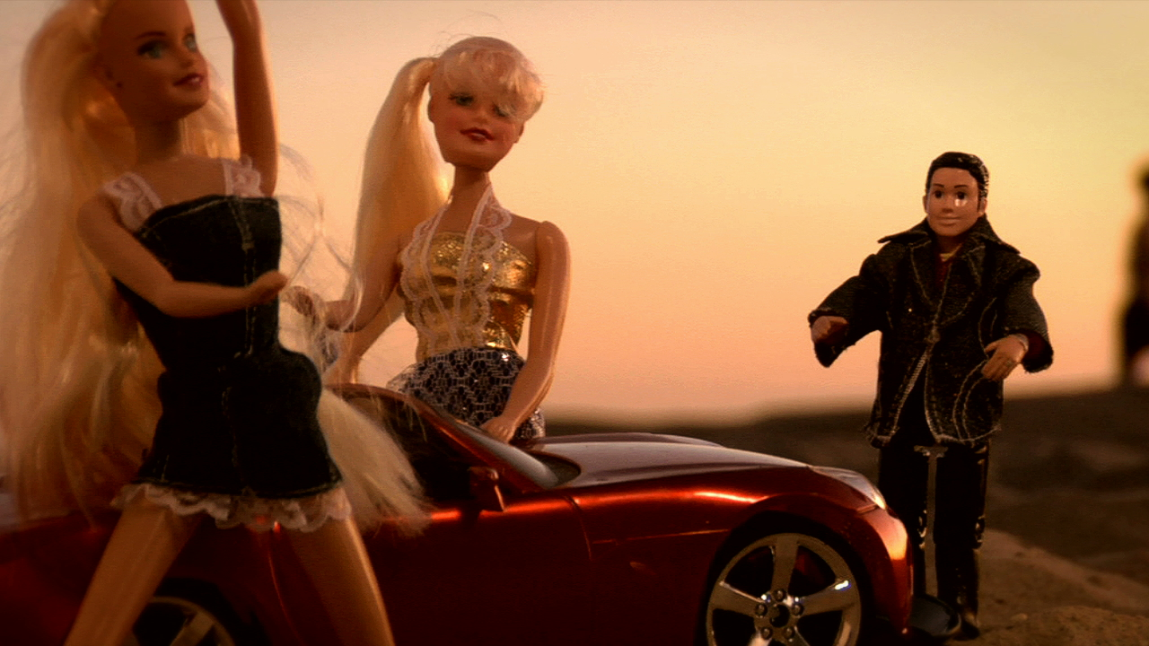 RJD2 - The Glow - screengrab - chillin by car with ladies.jpeg