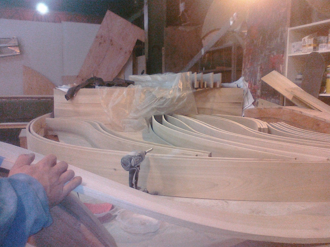 Poplar strips were heated in a custom steambox and then curved and clamped along premade molds.