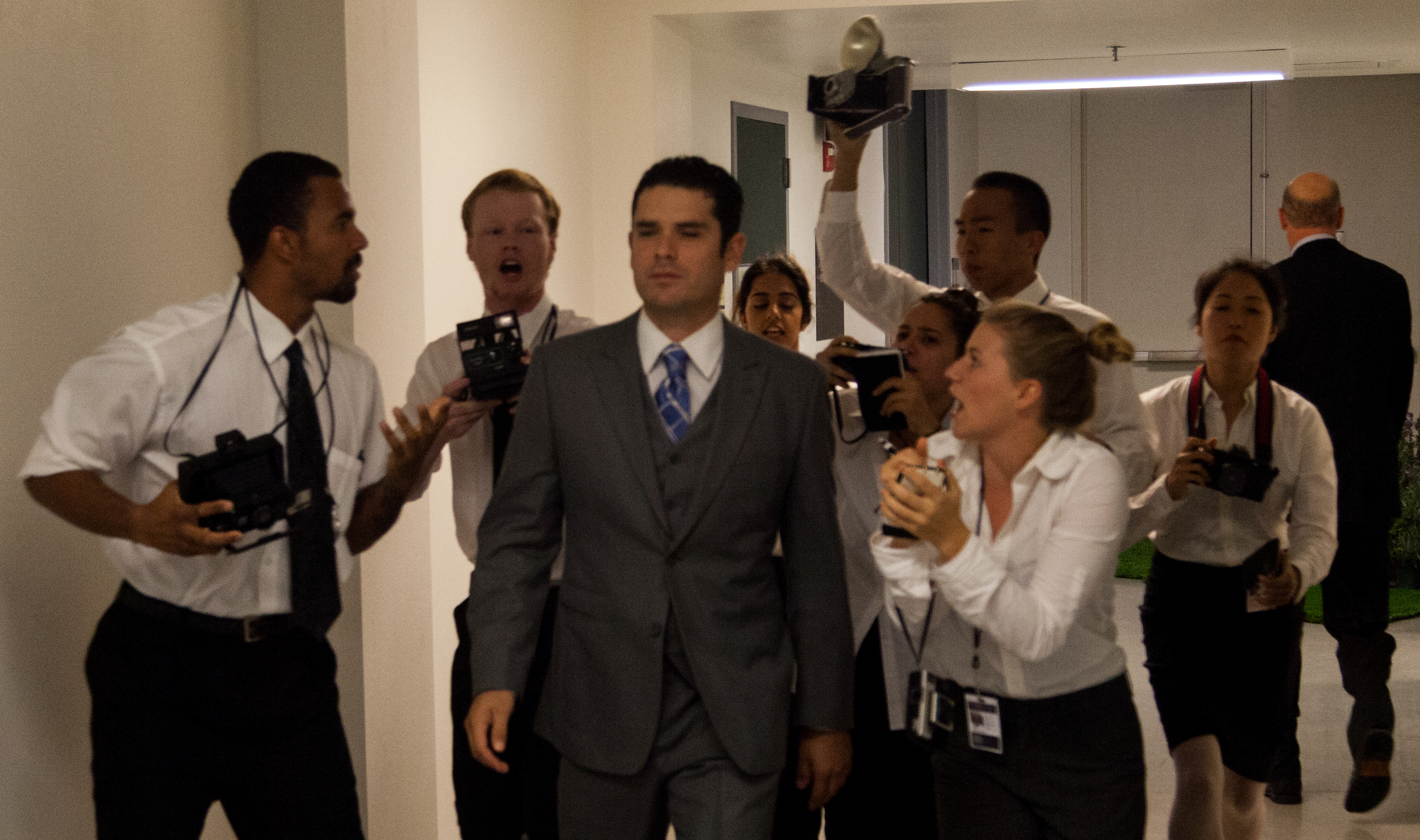 King Claudius (Jorge Rodriguez) is hounded by the paparazzi.