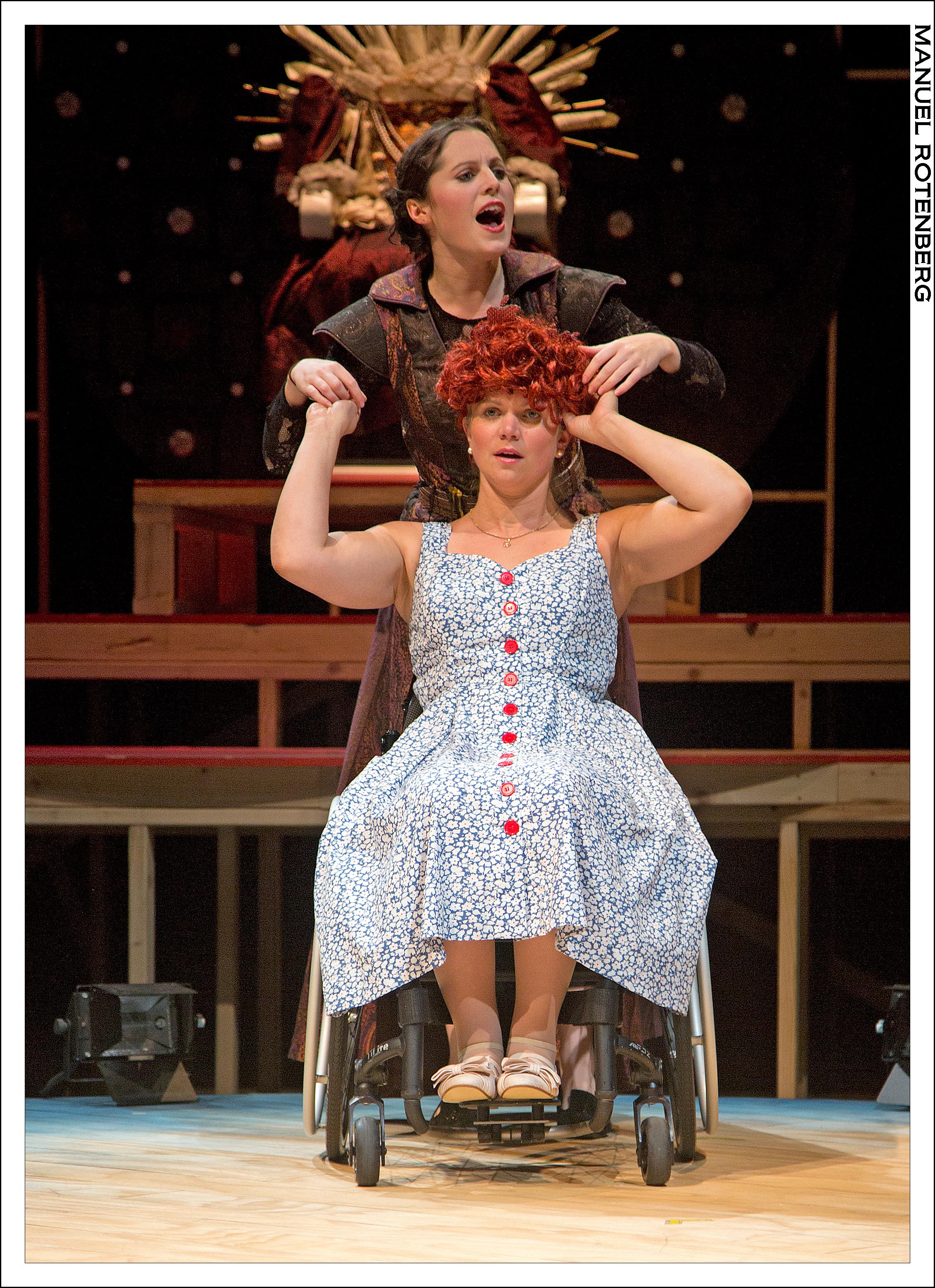 Pata Sola (Hannah Corrigan) dresses Regan Linton as Queen Elizabeth.