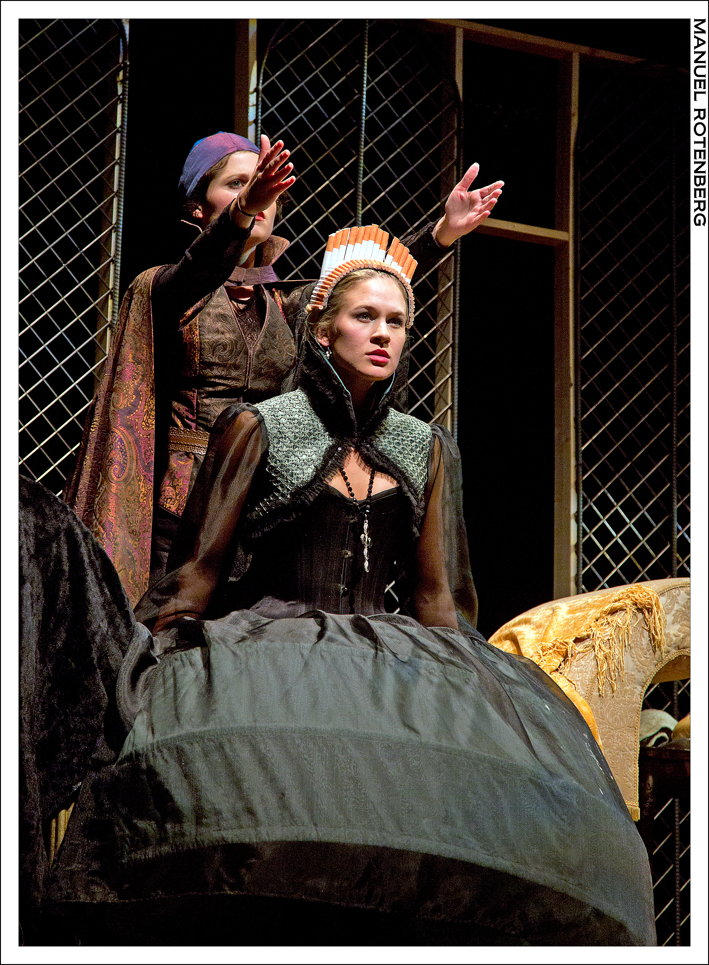 Nostradamus (Hannah Corrigan) shows Queen Catherine of France (Sarah Halford) visions of Mary Queen of Scots.