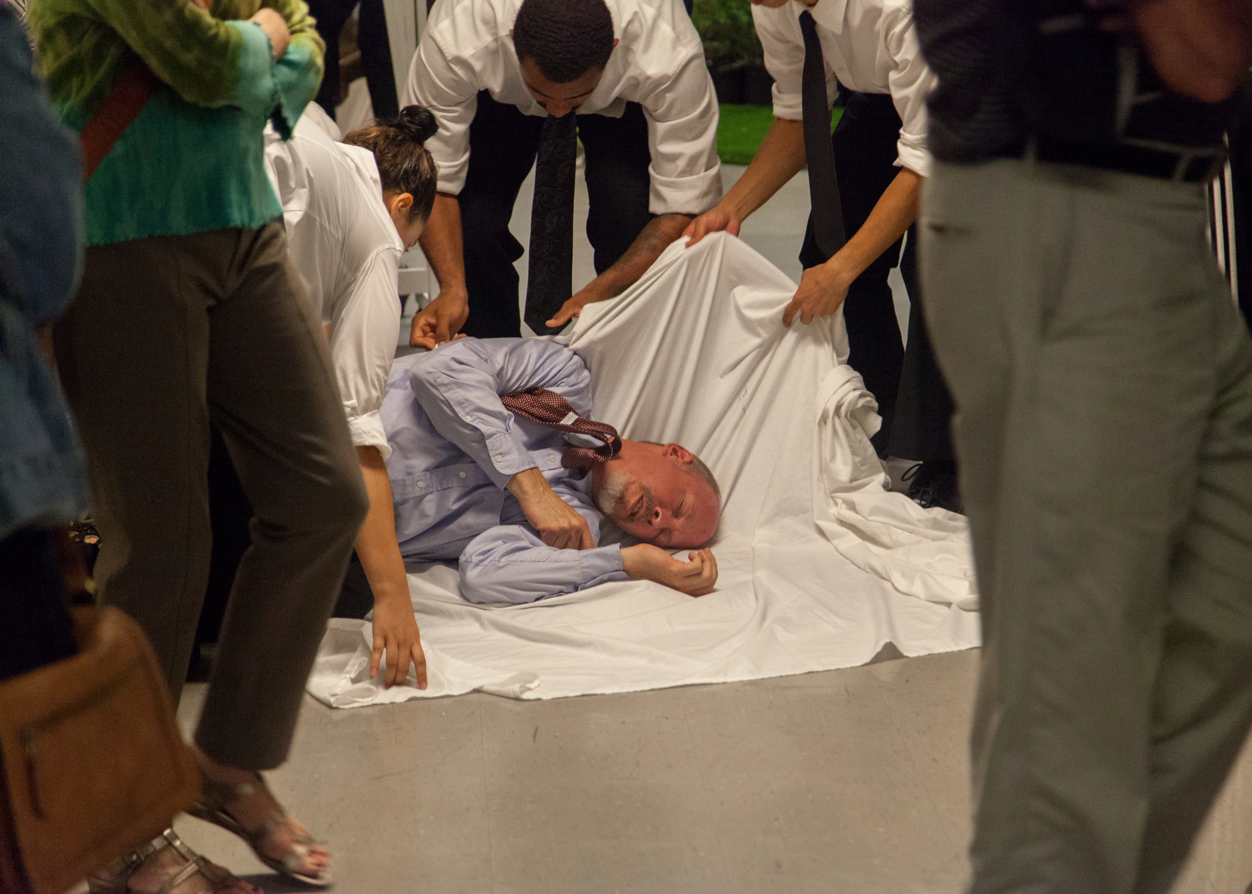 Polonius' (Mike Sears) body is quickly dispatched with after he is shot by Hamlet.