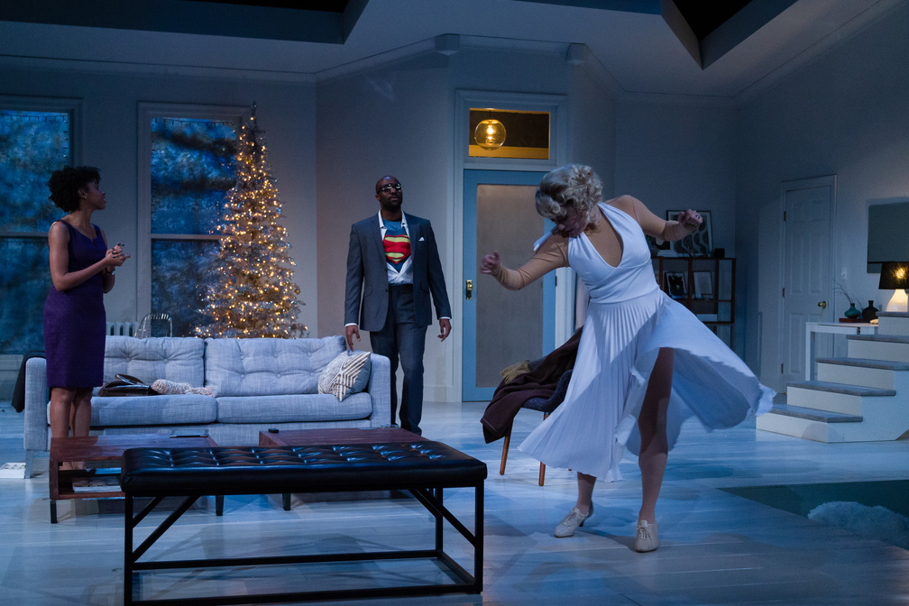 Nora (Kim Blank) and Torvald (Toby Onwumere) return from the costume party to find Kristine (Jasmine St. Clair) at their house.
