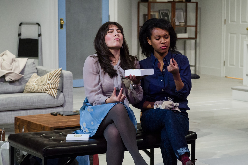 Nora (Kim Blank) and the nanny, Anna (N' Jameh Camara), share forbidden chocolates.
