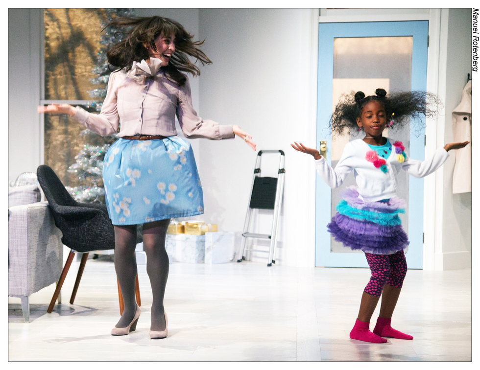"""Nora (Kim Blank) teaches her daughter Emmy (Lauren Rowe) how to do a dance to """"Santa Baby."""""""