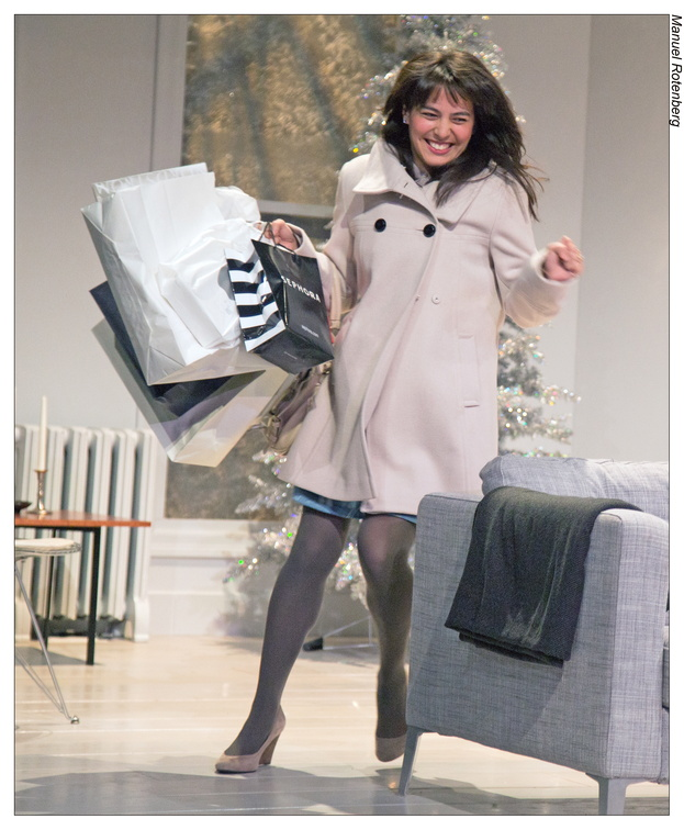 Nora (Kim Blank) returns from a Christmas shopping spree.