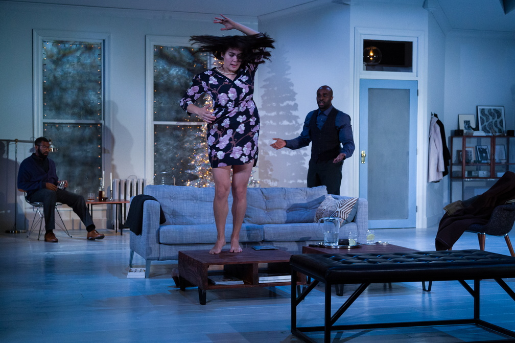 Nora (Kim Blank) dances to distract Torvald (Toby Onwumere) from checking the mail.