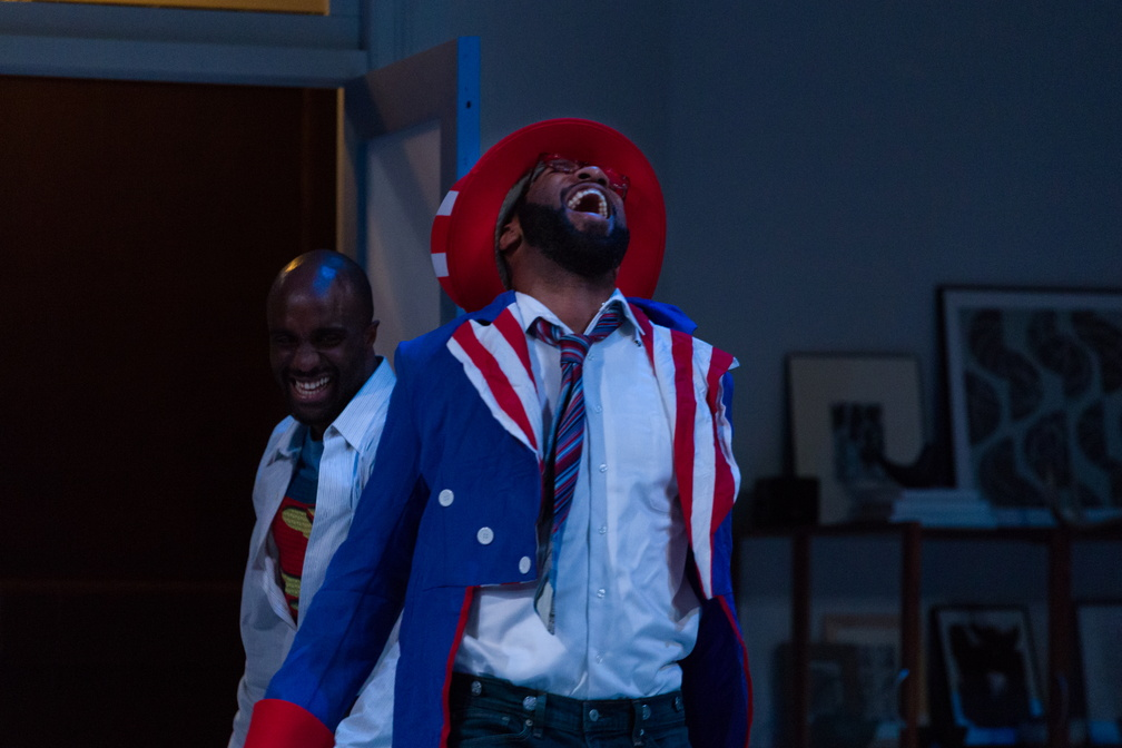 A very drunk Rank (Ronald Washington) comes to say a final goodbye to Torvald (Toby Onwumere) and Nora after the costume party.