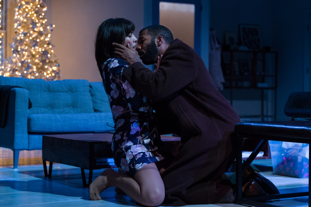 Rank (Ronald Washington) tries to kiss Nora (Kim Blank) after confessing that he is dying.