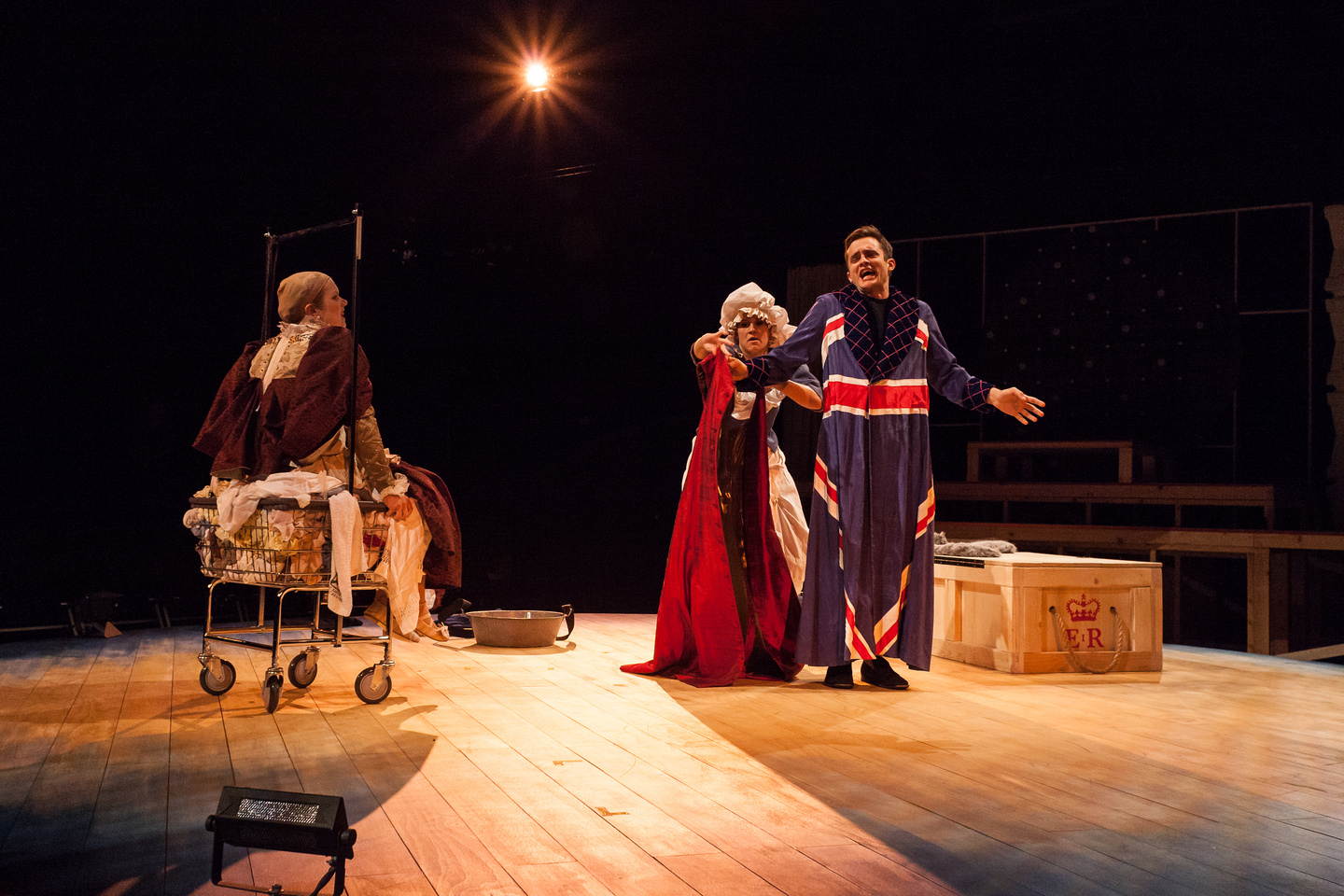 The laundress Tilly Boom (Sarah Halford) arouses Archibishop Whitgift (Brian Smolin) and Elizabeth (Regan Linton) by dressing them in their symbols of power.