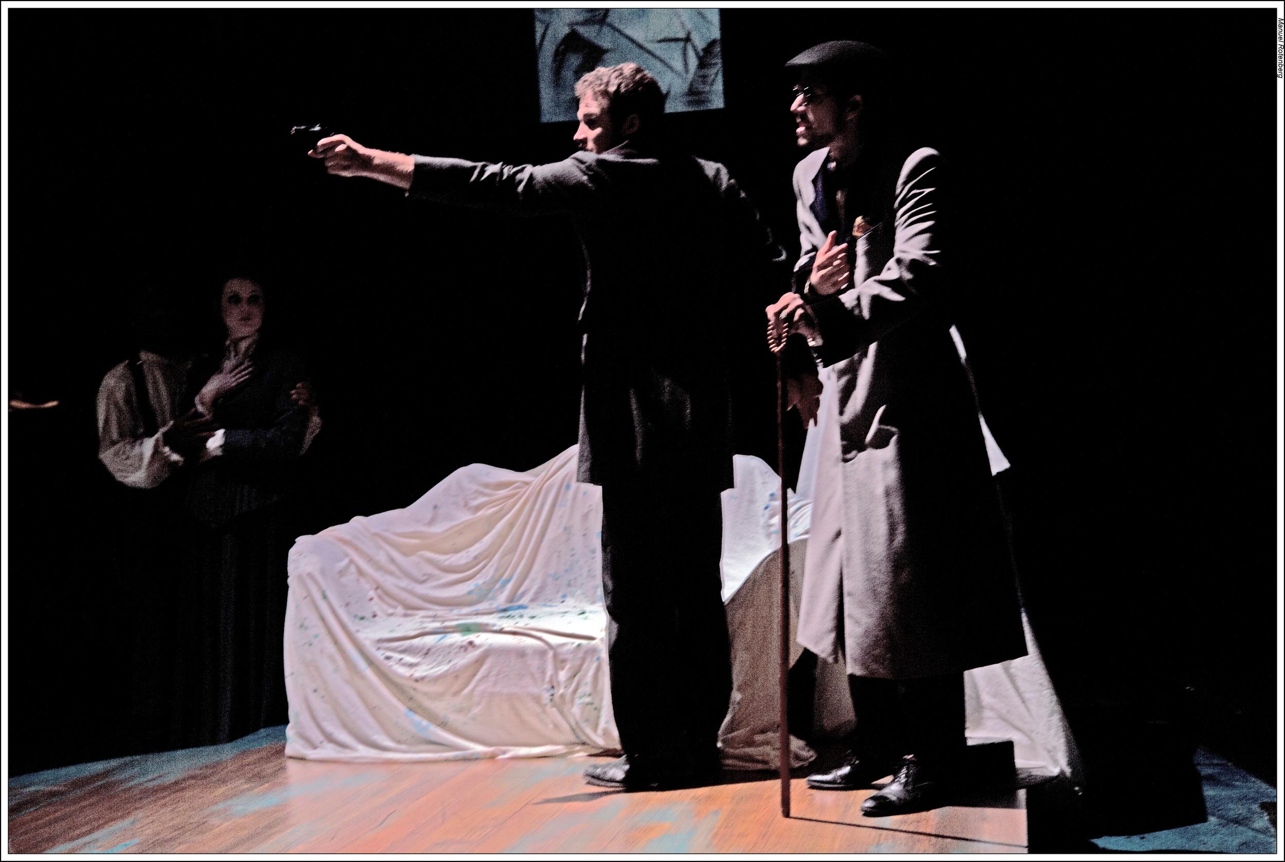 Casagemas (Michael Hammond) shoots Germaine and then himself.
