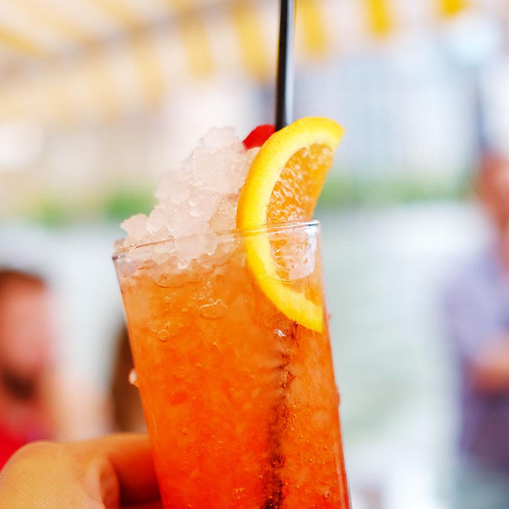 WILD'S NEGRONI ~ Gin, Campari, Sweet Vermouth, Muddled Strawberry and Orange
