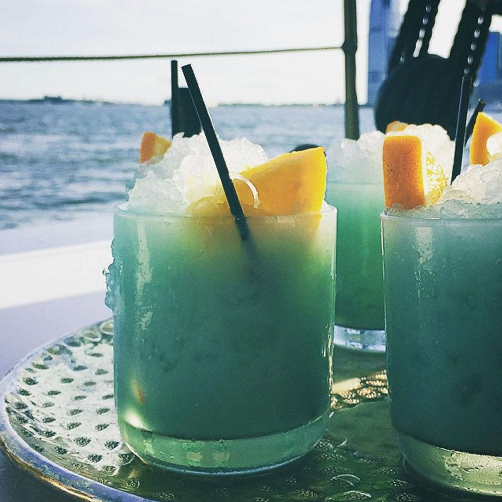 BLUE HAWAII ~ Vodka, Curaçao, Rum, Fresh Squeezed Orange
