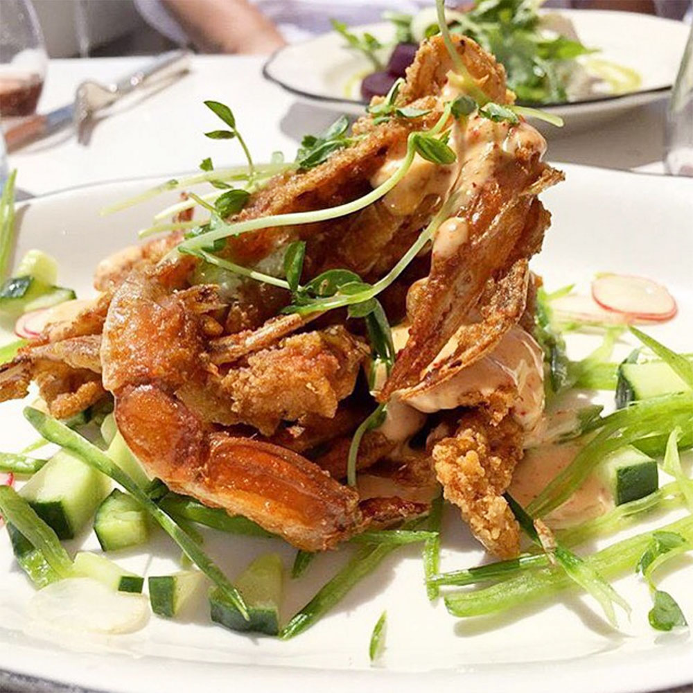 Fried soft shell crabs with lemon, herb, and espelette dresing, cucumber and snow peas