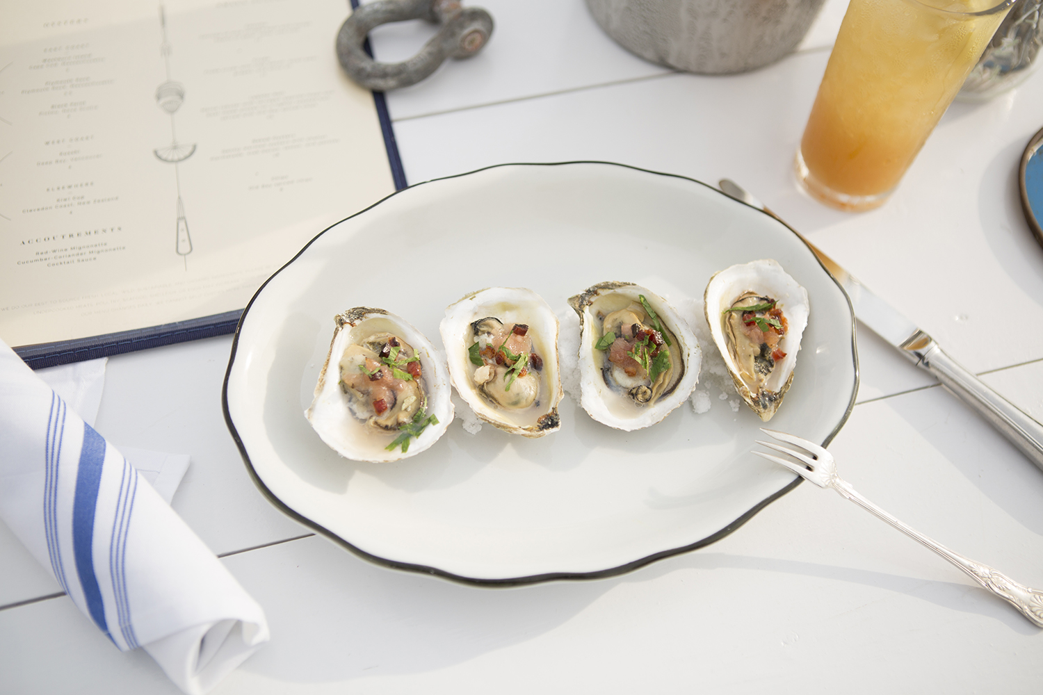 Baked oysters with shallot marmalade, slab bacon, lemon and parsley