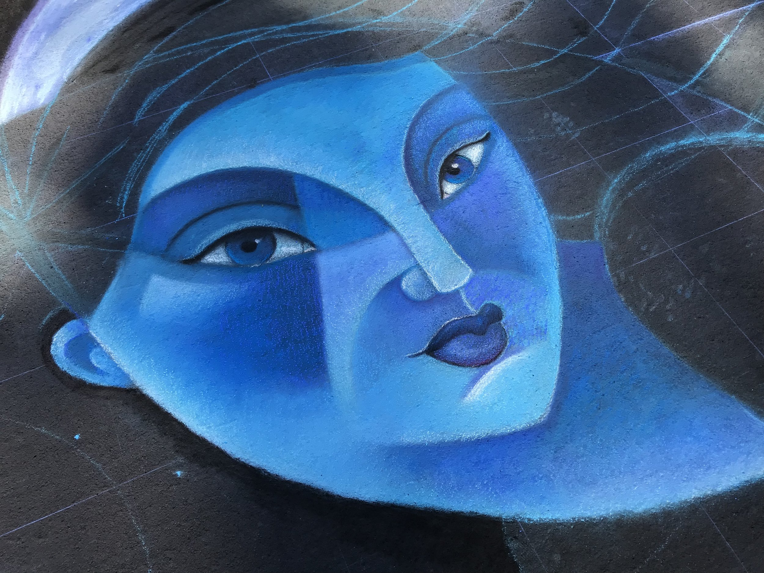 I almost always begin with the face. It establishes the palette/values for the rest of the mural and it is the most engaging element for anyone visiting the festival.