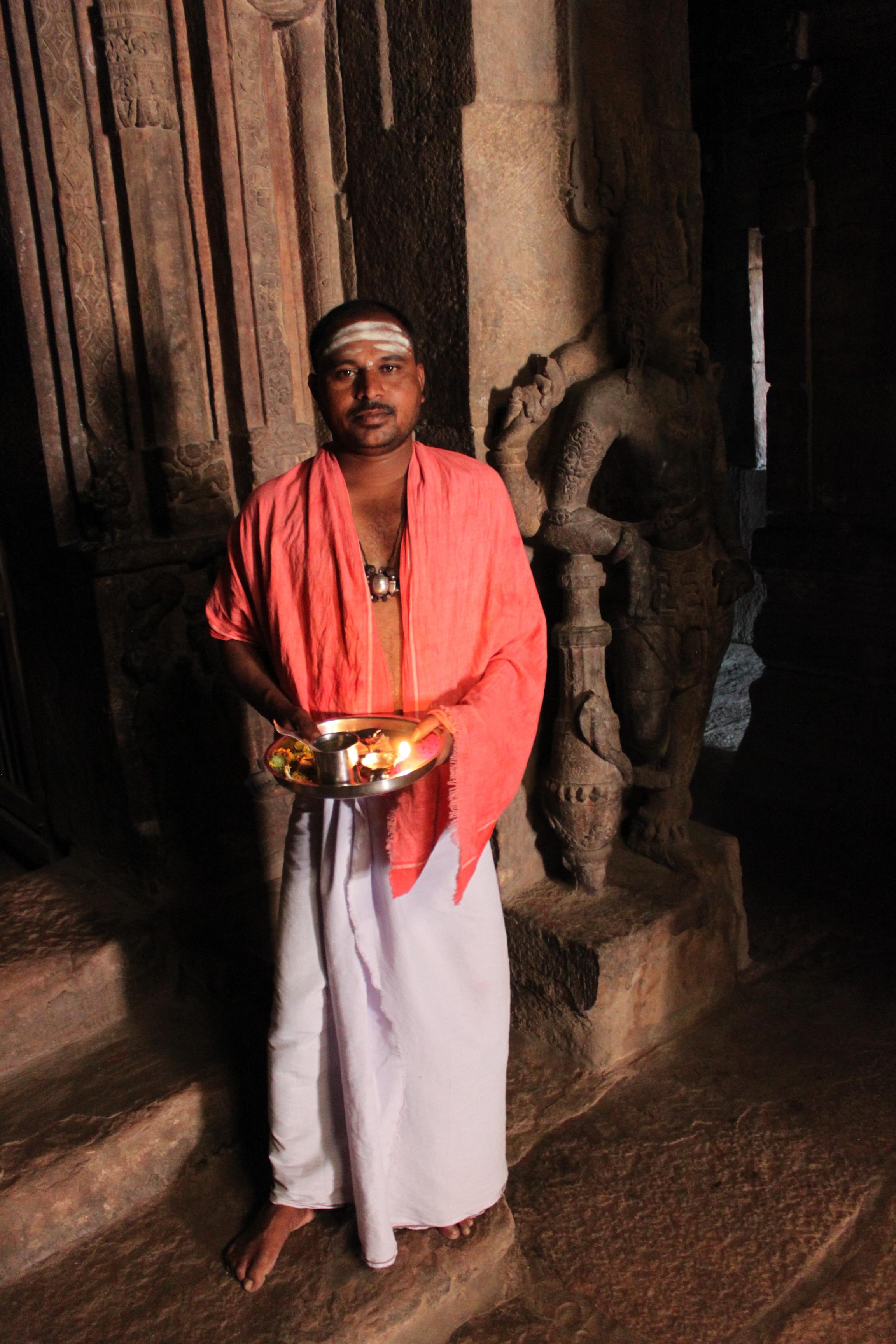 Priest in temple (Badami)