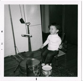 Amy at age 3. Who knew that drums would be my first instrument? I still play today!