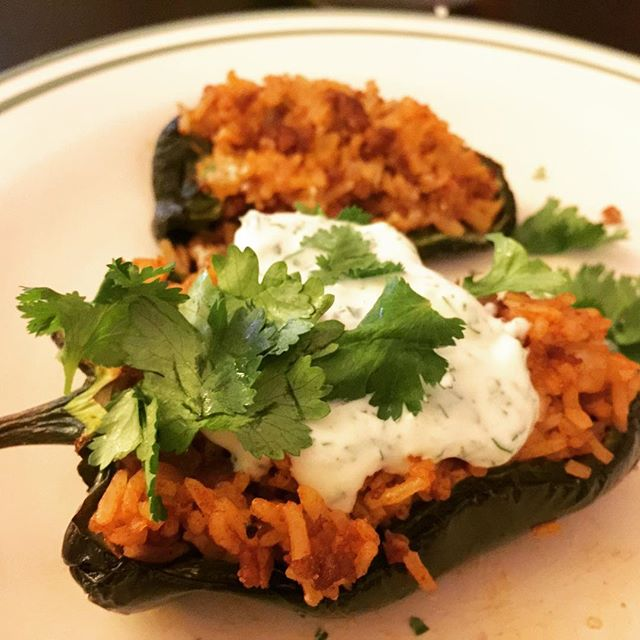 Stuffed pableno pepper from @wooozie's home garden, with rice and beef, topped with cilantro and crema mexicana. #homecooking