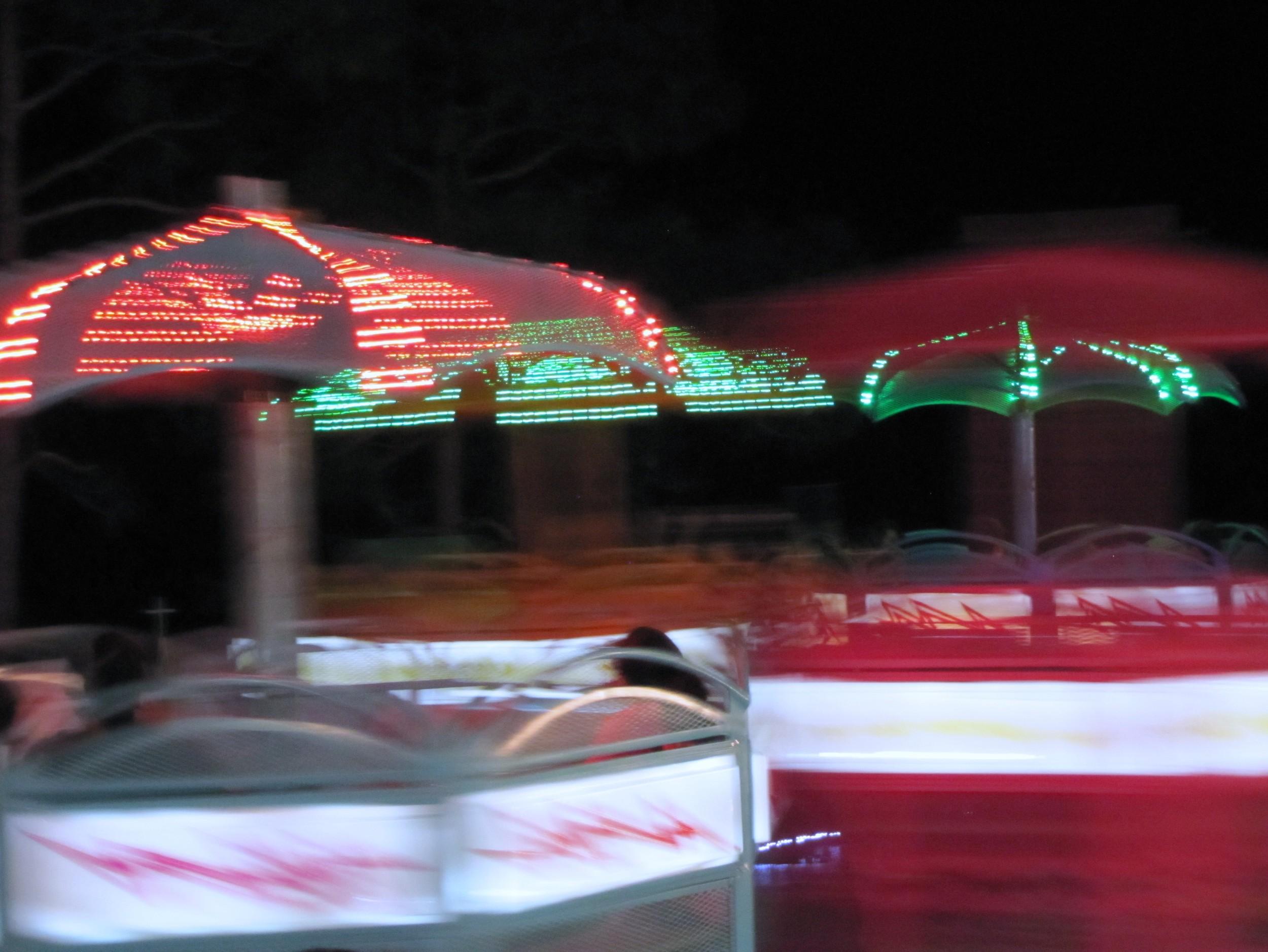 gigi reinette - carnival ride paradise amusements spinning umbrellas