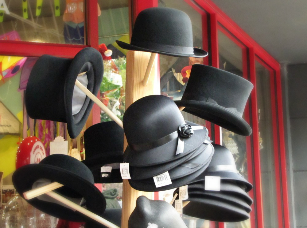 historic black hats by shop window