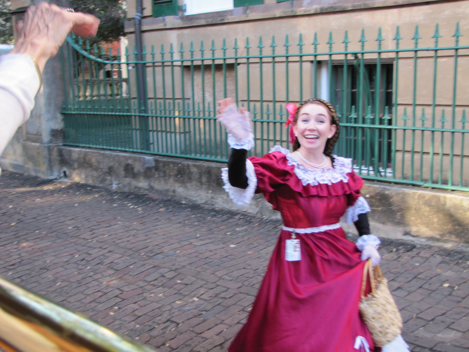 actress in historic costume on streets of Savannah