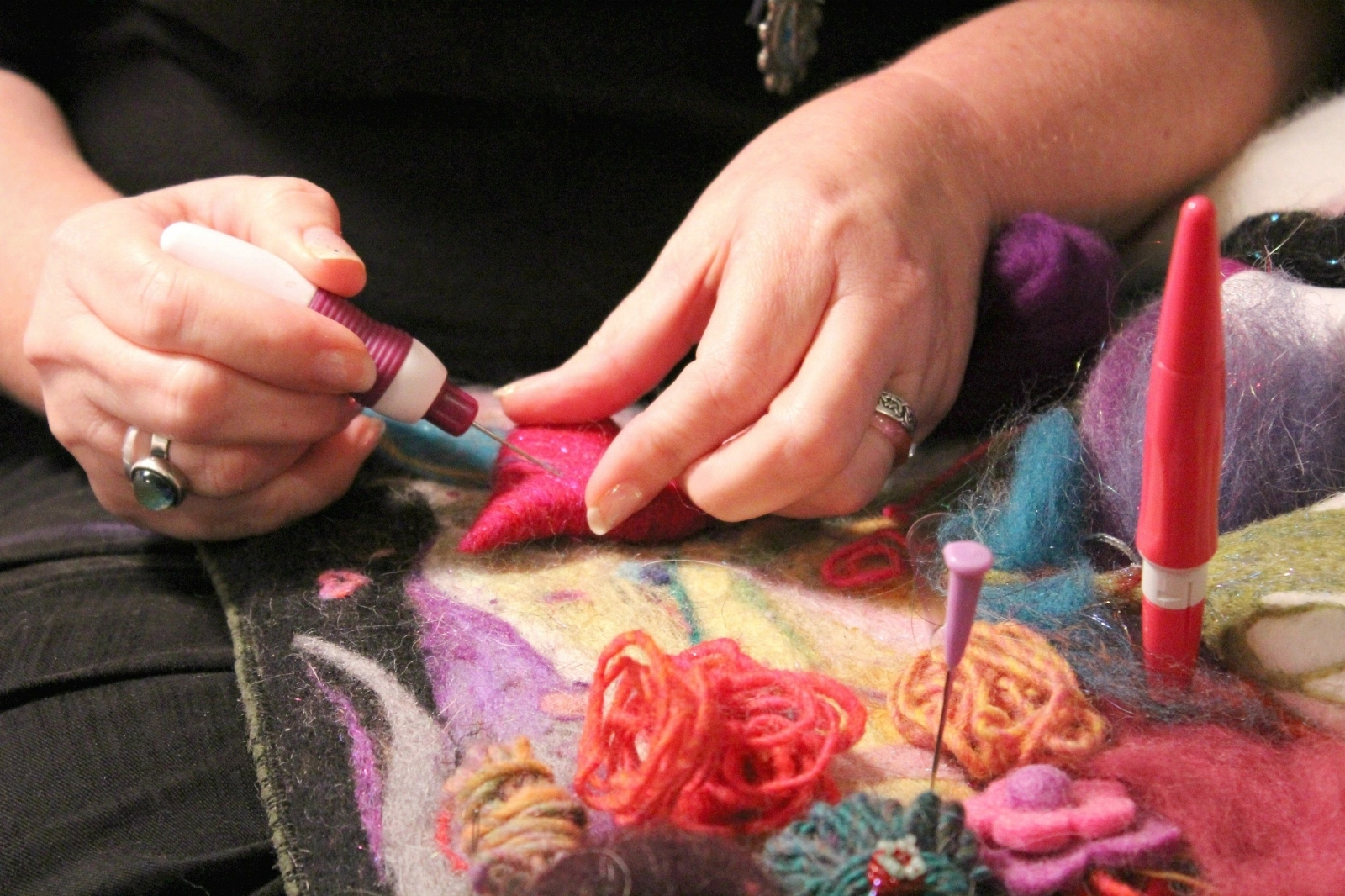 needle felting process with colorful wool