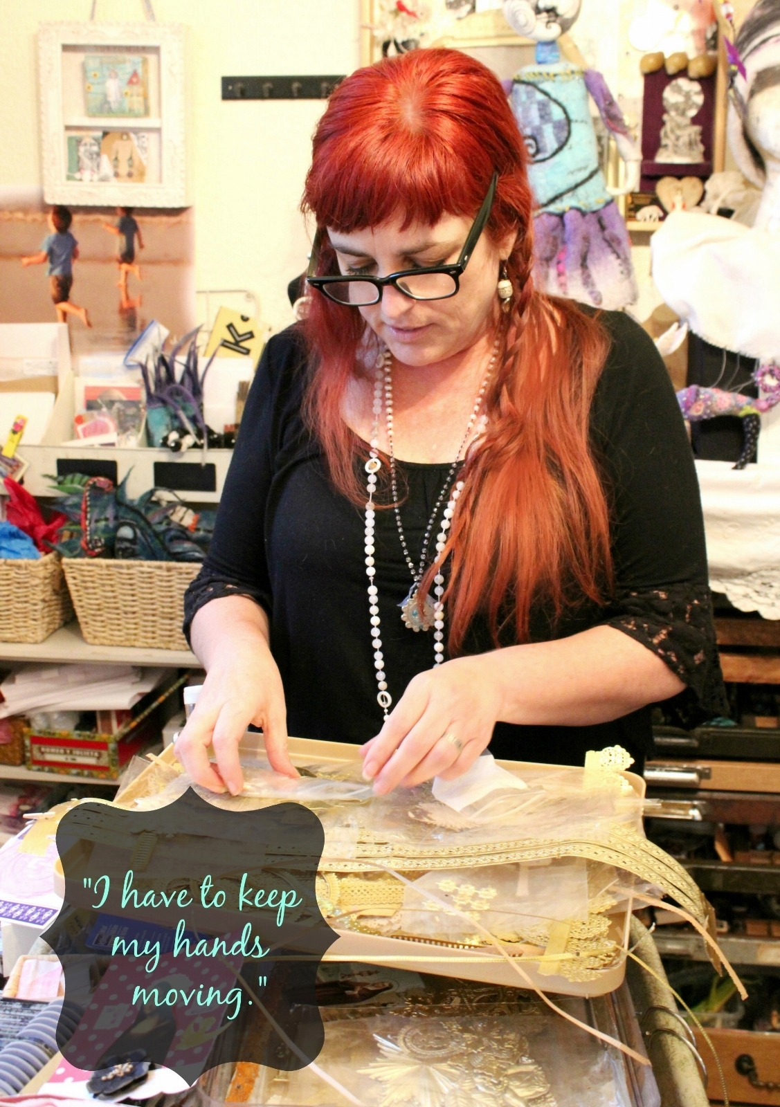 Artist Caroline Daley working in her studio