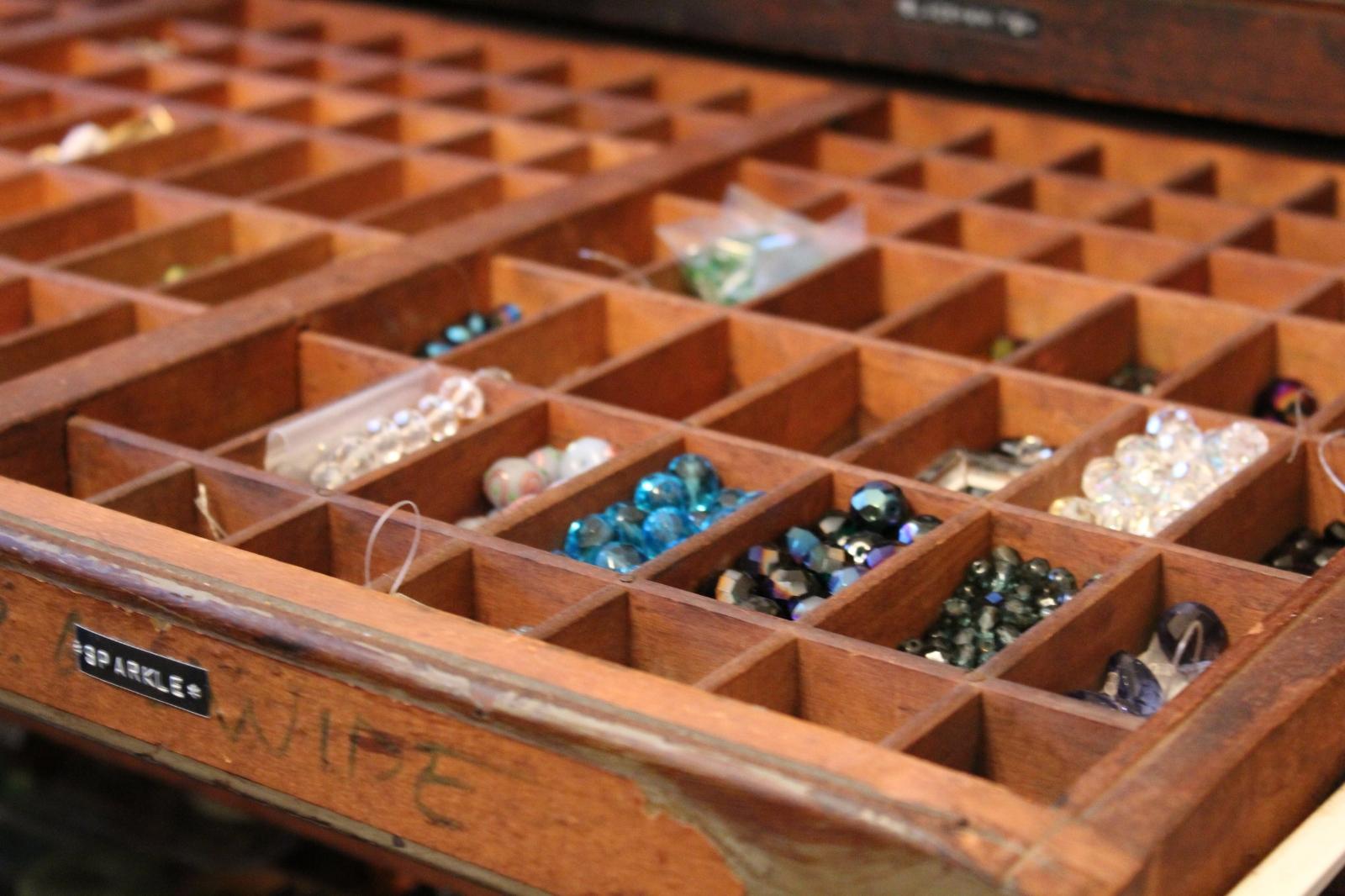 beads in vintage letterpress tray