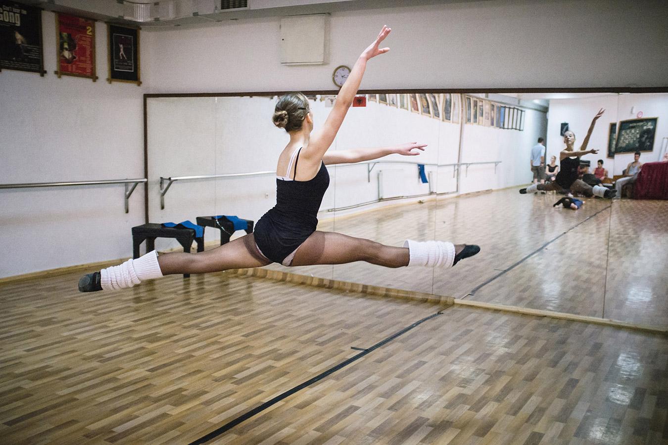 Etrita Abdullahu (15), a ballet student, makes a jump during a rehearsal.