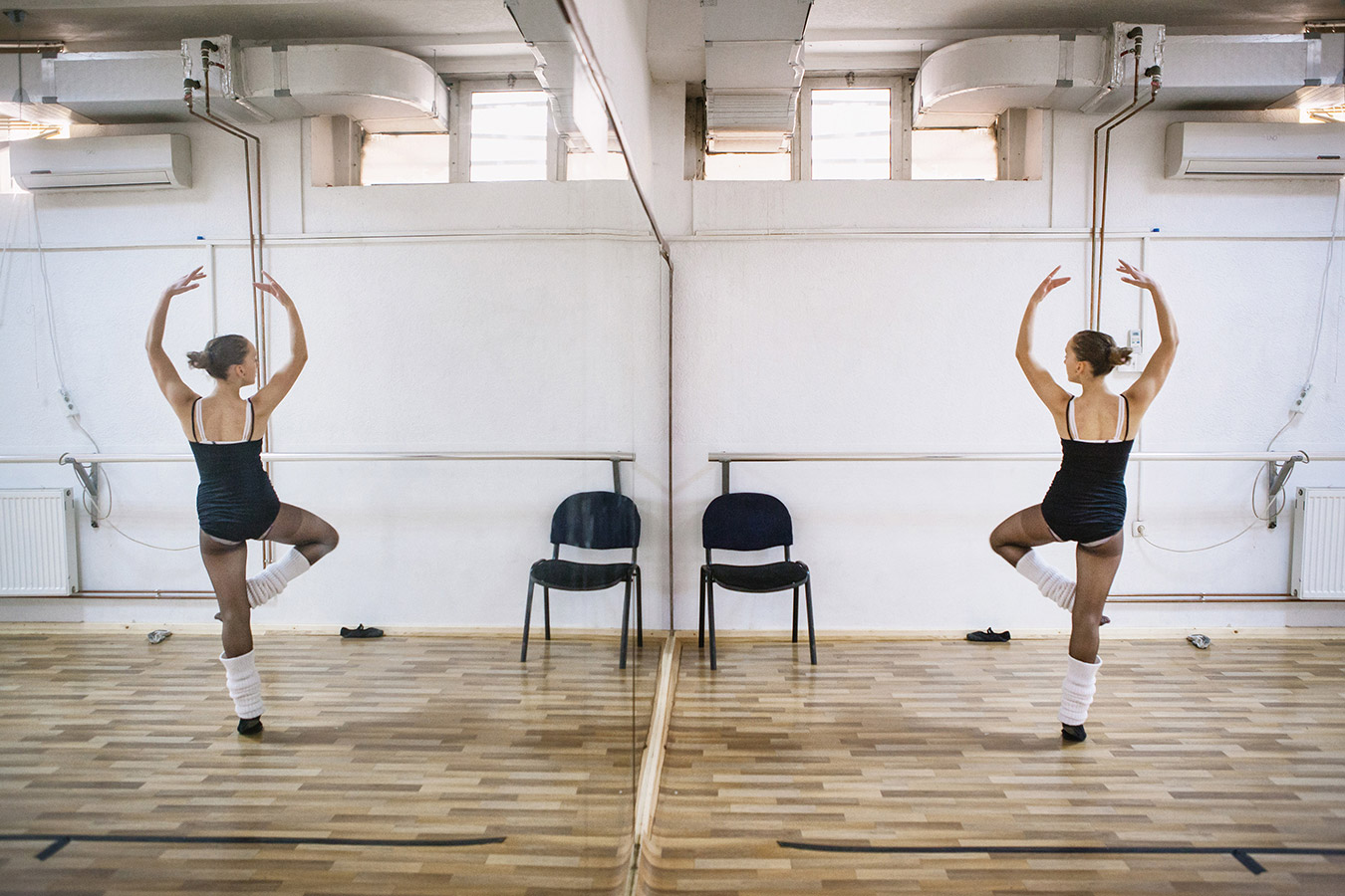 Etrita Abdullahu (15), a ballet student, watchs her move in the mirror during a daily rehearsal.