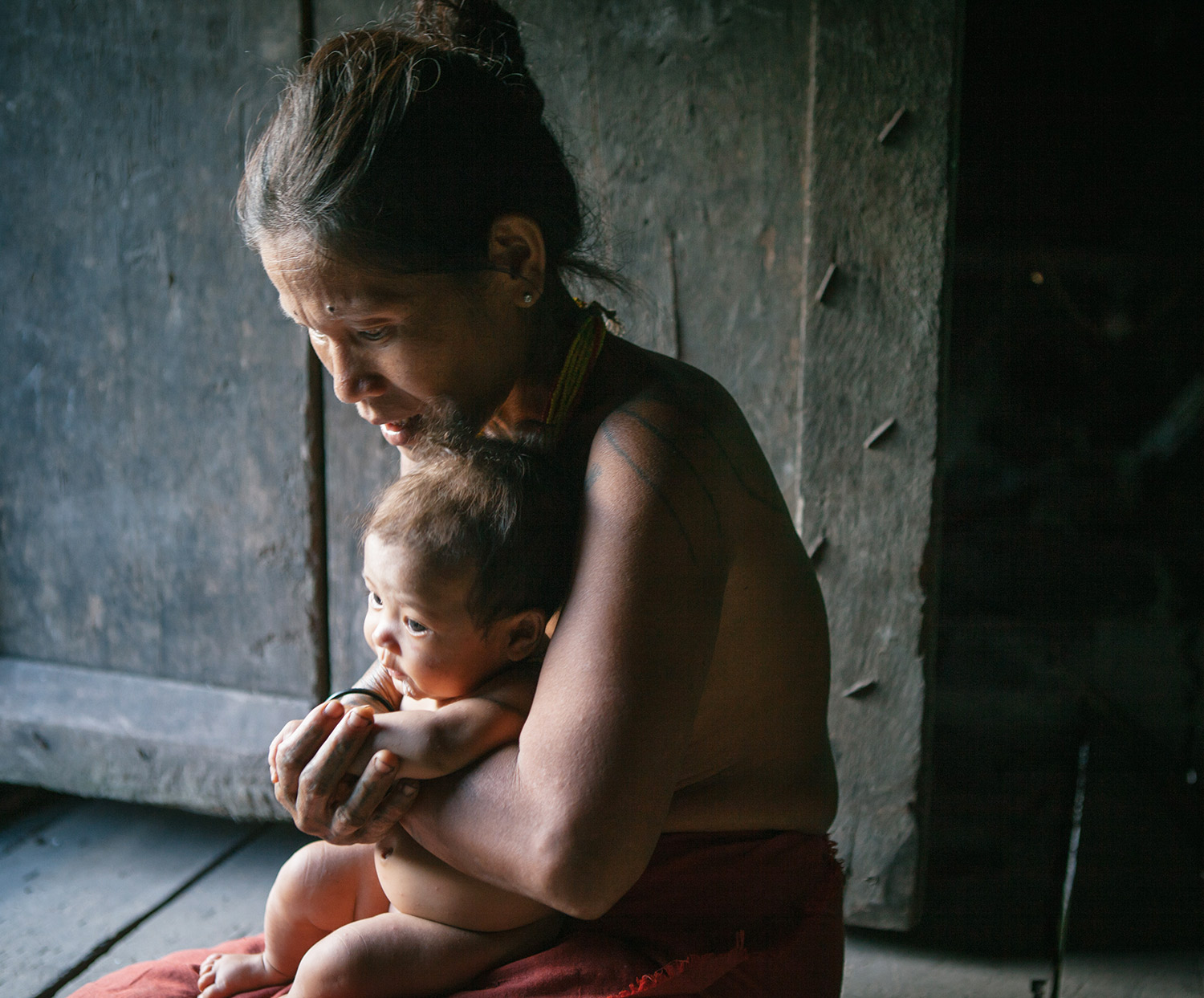 A Mentawai mother with her baby.