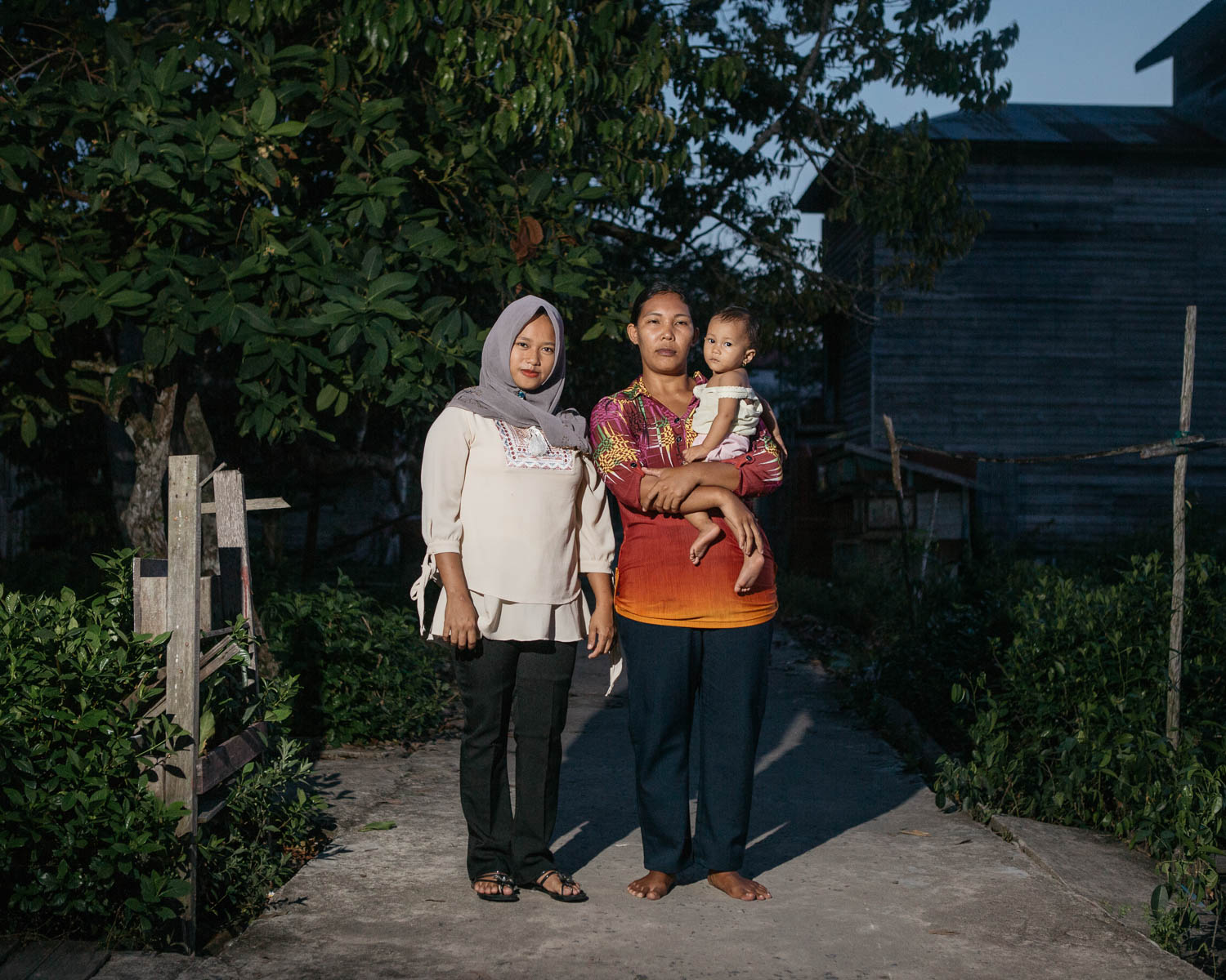 Portrait of Riska Asmaul Lifa (left) and Halisa (right), villagers from Mendawai who are benefited from Katingan Mentaya Project's micro credit program.